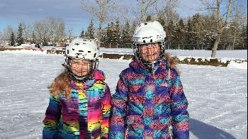 Girls on Outdoor Rink Picture (with waiver).jpg